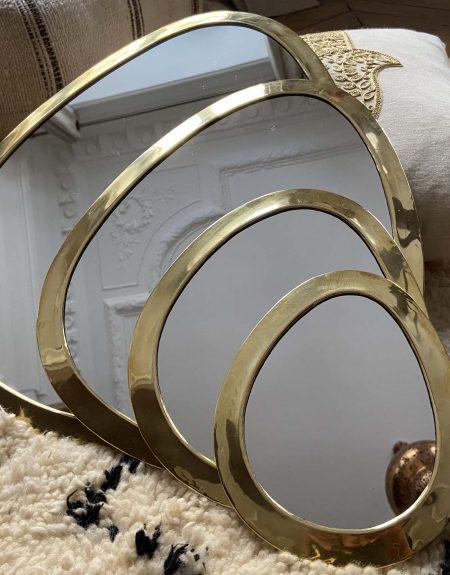Miroir ogive doré à bord épais